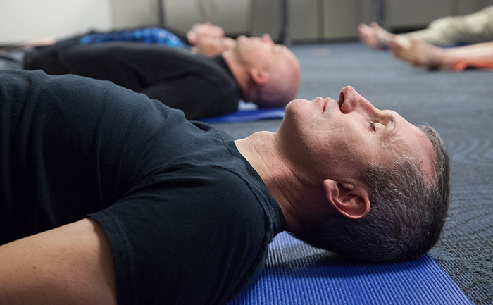 Mindfulness, a method to prevent and manage stress, is built into the yoga classes. It's also offered as a separate 10-minute session at the end of patrol shifts.